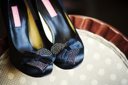 Black Betsey Johnson pumps with heart and bow details