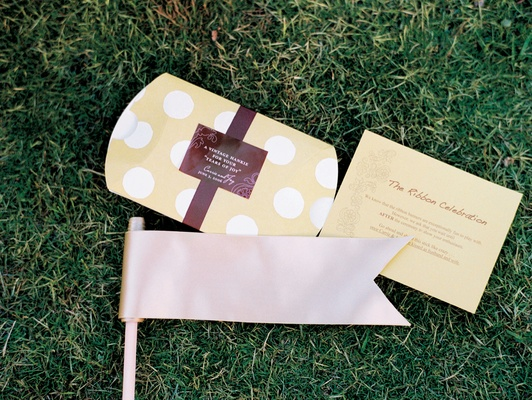 Wedding ceremony favors on green stationery