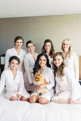 bride brooke squires and bridesmaids pomeranian cupcake the pom on bed in robes getting ready