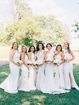 Bride in illusion beaded lace wedding dress with six bridesmaids in mismatched white dresses