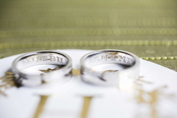 grooms wedding bands engraved with each other's initials