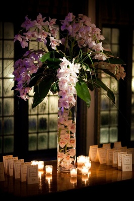 Tall orchid flower arrangement at wedding reception