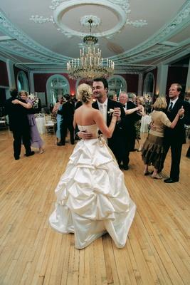 Bride dancing in Monique Lhuillier bridal gown