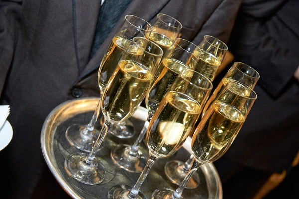 White wine sparkling champagne served by the tray at cocktail hour