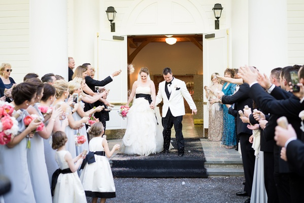 guests toss eco friendly confetti grand exit ceremony couple southern wedding greenbrier chapel