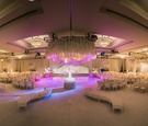 white hued reception space purple lighting indian hindu wedding california furniture ballroom