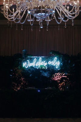 Suzanna Villarreal and Alex Wood LA Dodgers wedding wood vibes only reception sign by dance floor dj