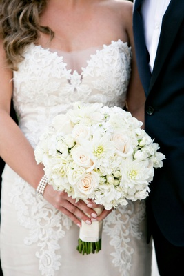 Bride in Ines Di Santo wedding dress lace with pearl bracelet and pink manicure white bouquet flower