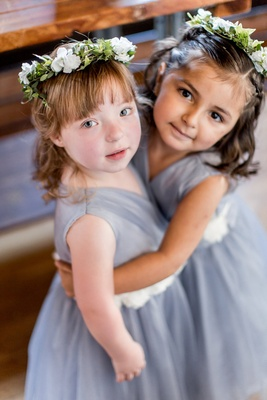Flower girls with flower crowns blue grey dresses white sash bangs flower crown