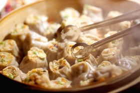 Wedding cocktail hour appetizer of steamed dumplings, The Standard Club, Chicago