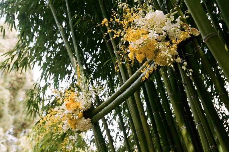 Wedding ceremony altar made of bamboo and yellow roses