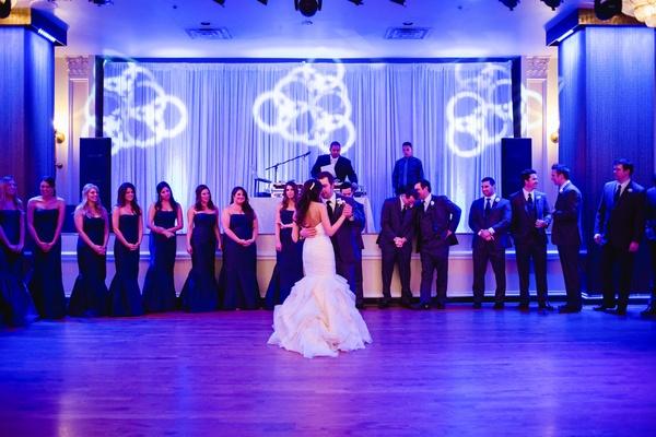Bride in mermaid gown dancing with groom