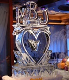 Heart-shaped ice sculpture with couple's initials