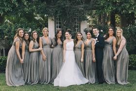 bride in romona keveza, beaded belt, bridesmaids in grey monique lhuillier gowns, bridesman in suit