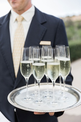wedding ceremony cocktail hour champagne in flutes with round silver tray outdoor wedding