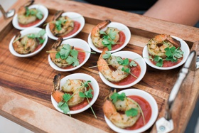 bridal shower hors d'oeuvres ideas, shrimp in sauce on small white dish
