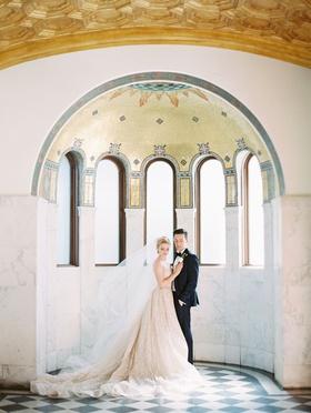 bride and groom portrait downtown los angeles venue vibiana mosaic arch checkerboard floor lazaro