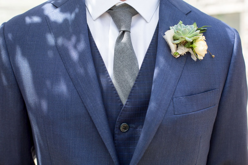 groom in navy blue three piece suit grey tie succulenet wedding boutonniere rustic chic