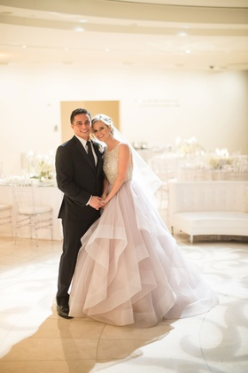 Bride in blush dress with groom in black suit