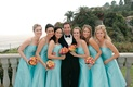 Bridesmaids and groom with ocean view