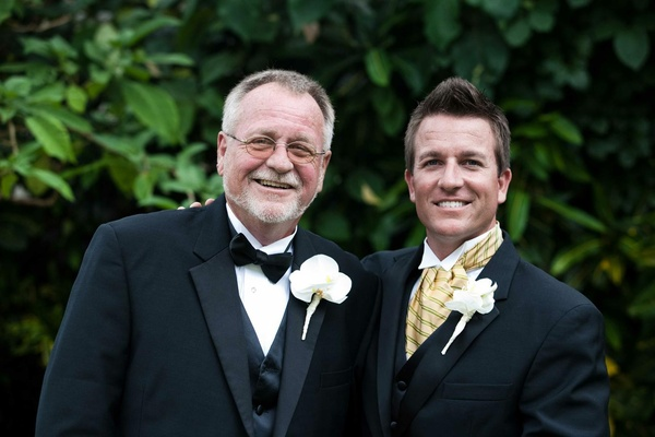 Groom with father of the groom in tuxedos
