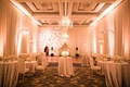 Wedding reception after party linens on cocktail tables dining chairs dance floor chandelier