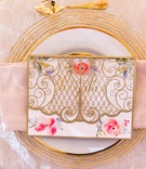 menu card with folded gold laser-cut and flower print