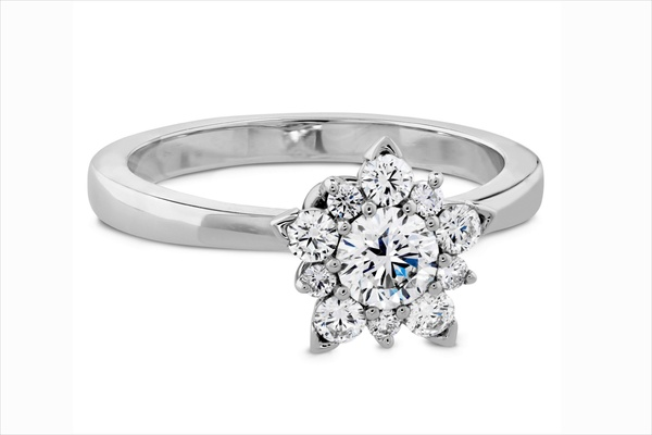 Hearts On Fire solitaire diamond engagement ring with snowflake halo