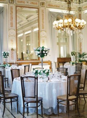 wedding reception high low centerpiece greenery white flowers candelabra vintage inspired design