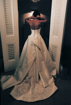 Back of bride's satin wedding dress with gold details