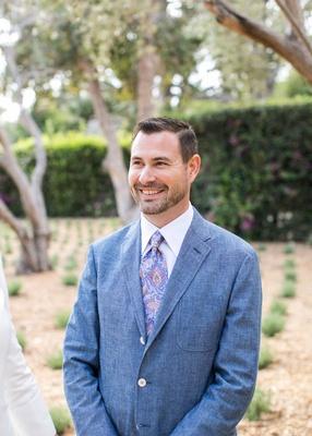 Groom in blue wool jacket with paisley tie for Santa Barbara wedding