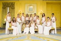 Bridesmaids in hotel ballroom with pink floor length dresses
