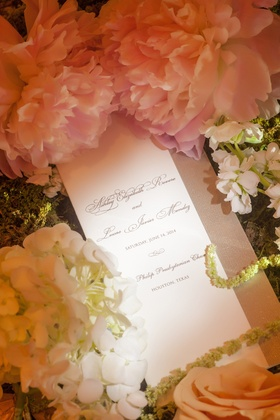 Wedding ceremony program with pink peony flower