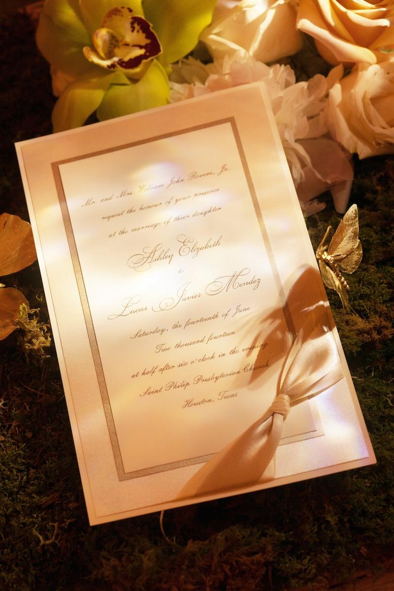 Calligraphy script invitation with bow in corner