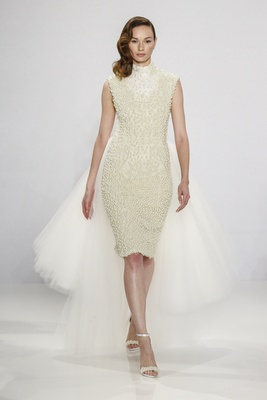 Christian Siriano for Kleinfeld Bridal short sleeveless wedding dress with pearl beading high neck
