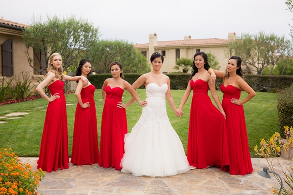 bride in liancarlo, bridesmaids in strapless red dresses with sweetheart neckline