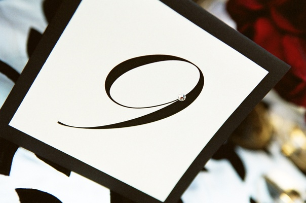 Black table number on white stationery with diamond