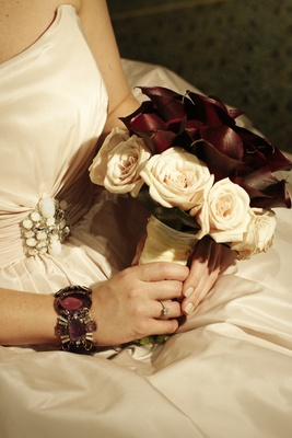 Bride's bouquet of maroon calla lilies and pale pink roses