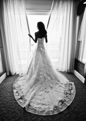 Black and white photo of back of bride's wedding dress