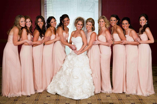 Bridesmaids in blush, floor-length gowns