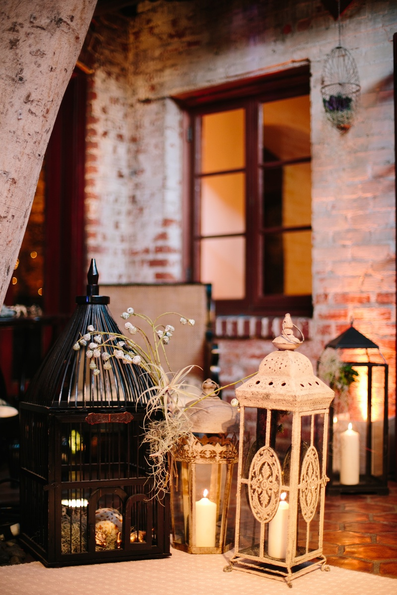 White and black lanterns with candles and branches