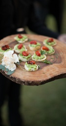 Tray-passed hors d'oeuvres on tree slice