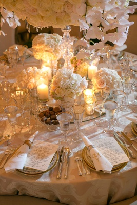 Gold napkin ring and embroidered linen with gold-rim glassware