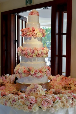 Seven layer cake with fresh roses in blush as tiers