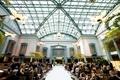 wedding ceremony harold washington library chicago tall ceiling skylight greenery chandelier garden