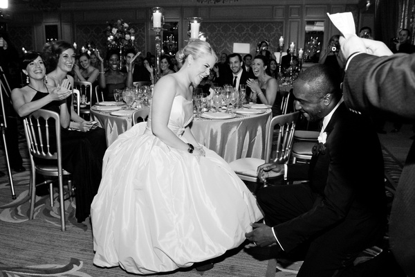 Black and white photo of bride and groom at reception