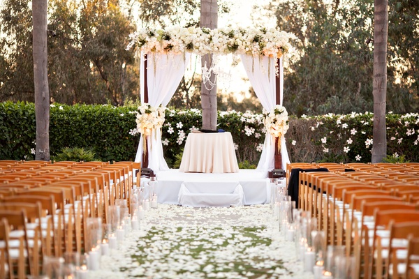 white décor for outdoor ceremony, California wedding flower petals on grass lawn aisle