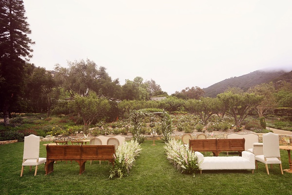 intimate wedding with couches, chairs, and benches