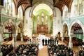 traditional church wedding with high ceilings and arches