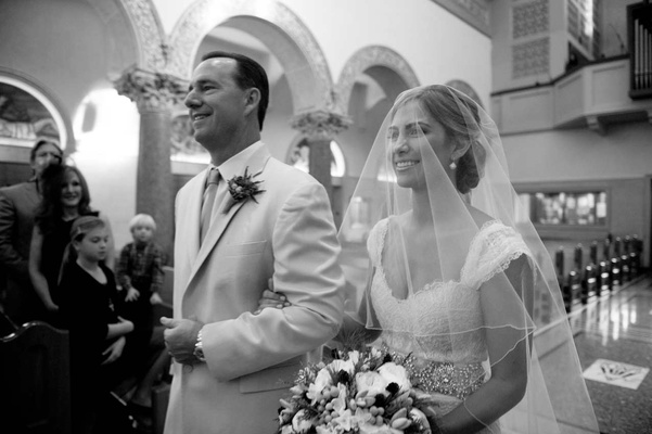 Dad walking bride down church aisle